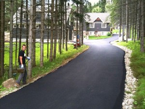 paved driveway through trees